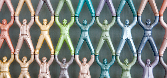 Detail from Do-Ho Suh's Screen Art work, small figures standing on each other, linked by hands and feet.